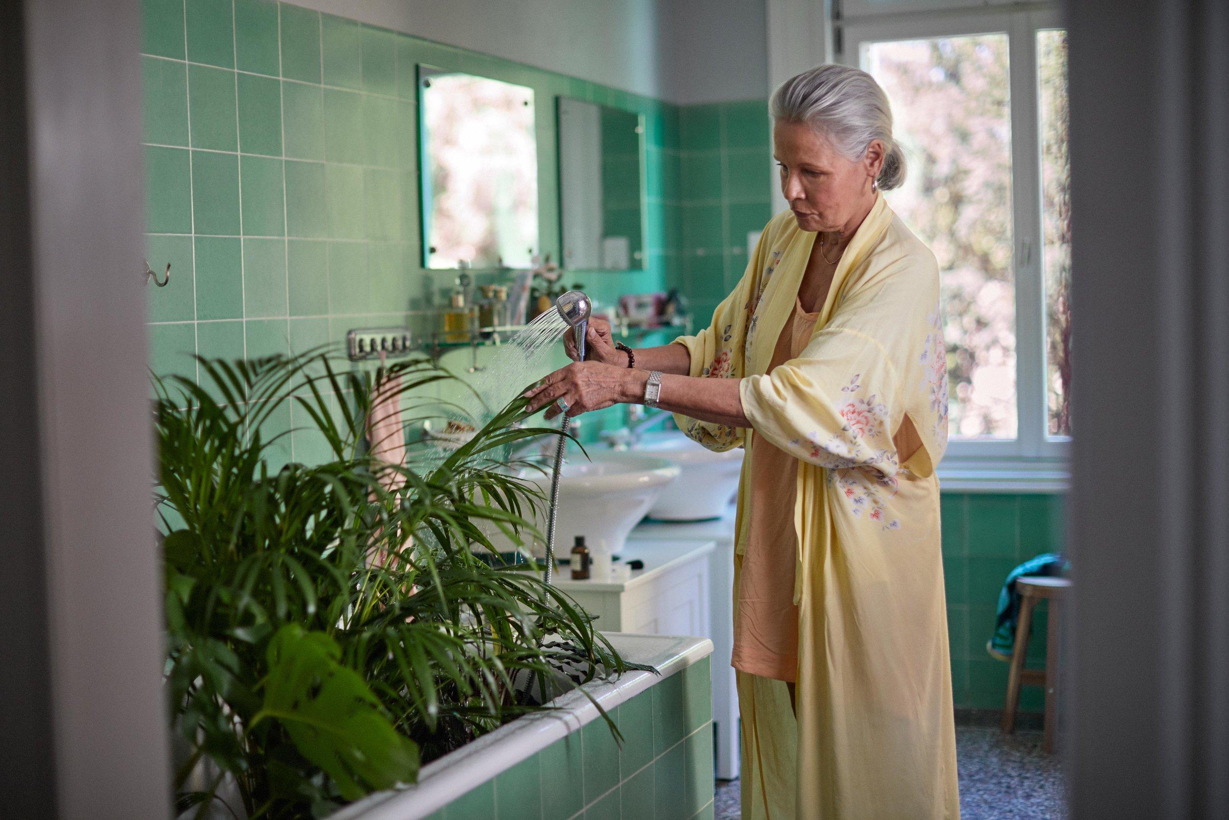 #1+WOMAN+WATERING+PLANTS9968+WARMERcopy
